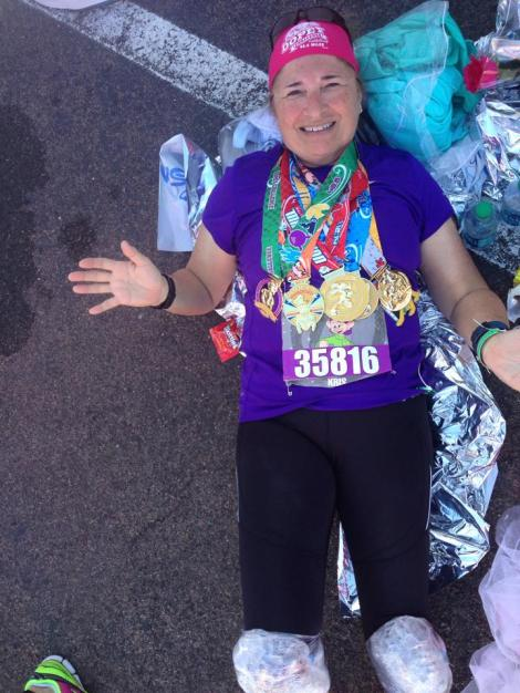 You can see the rose on the ground next to her.  Don't marathons look fun???